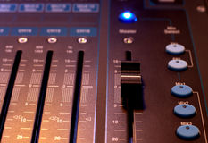 Sound studio adjusting record equipment Royalty Free Stock Photography