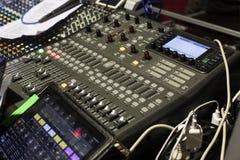 Sound studio adjusting record equipment. Royalty Free Stock Image