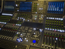 Sound studio adjusting record equipment. Royalty Free Stock Images