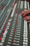 Sound studio mixer. Audio mixing board with hands Stock Photo