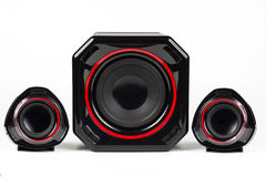 Sound System. 3D sound system build from 3 way speakers and a woofer all black with red circle isolated on white background royalty free stock photography