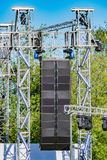 Sound system by the stage at concert time. Open air event equipment. Summer outdoor music festival preparation royalty free stock photo