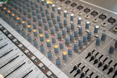 Sound technician audio mixer equalizer control for background. Close up of music mixer equalizer console for mixer control sound device. Sound technician audio stock photography