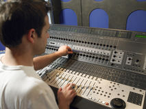 Sound Technician In Recording Studio. Young male sound technician in recording studio Royalty Free Stock Image