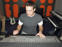 Sound Technician In Recording Studio. Young male sound technician in recording studio Stock Image