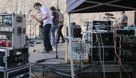 Sound testing time before show. Musicians prepare their set before a live show  on a Rock festival in the FiraB arts and music festival in Palma de Mallorca Stock Photos