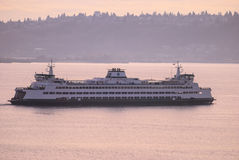 Sound Transit Ferry headed out at dusk Royalty Free Stock Photography