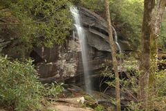 The sound of water falls are so relaxing. Drizzling onto the rocks below Royalty Free Stock Photo