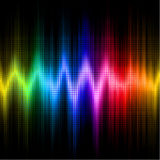 Sound wave display with visible spectrum colors. A rainbow-colored sound wave set against a black background Royalty Free Stock Image