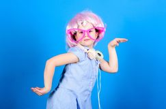On sound wave with technology. Small child wearing wireless stereo headphones in party style. Technology and music. Stereo sound technology. Modern technology royalty free stock image