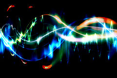 Sound waves. As colorful light beams in black background Stock Photography