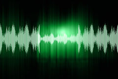 Sound waves. Digital design of sound waves on green background Royalty Free Stock Photography