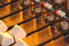 Soundboard. Golden light falling across mixing soundboard Royalty Free Stock Photography