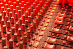 Soundboard. Music soundboard under red stage lighting Stock Images