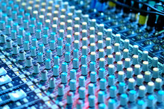 Soundboard. Mixing desk under blue theater lighting Royalty Free Stock Photography