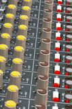 Soundboard close-up. Close-up of a soundboard mixer dials and led lights Royalty Free Stock Photo