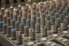 Soundboard control knobs. Close up of dials and knobs on audio soundboard control panel Royalty Free Stock Photography