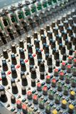 Soundboard Dials. Selective focus on knobs and dials on this audio mixer soundboard Stock Images