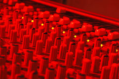 Soundboard LED's. Mixing soundboard in red lighting with green LED's Stock Image