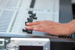 Soundboard. Man hand works on soundboard at concert Stock Image