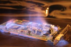 Soundcard  in the fire Royalty Free Stock Photo