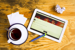 Soundcloud. Flat lay of tablet, cup of tea, pen and papers. Soundcloud is on the screen stock photo