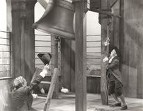 Sounding the bell Stock Photo