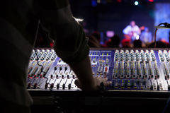 Soundman working on the mixing console. Hands on the sliders Royalty Free Stock Photos