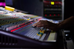 Soundman working on the mixing console. Hands on the sliders Stock Photos