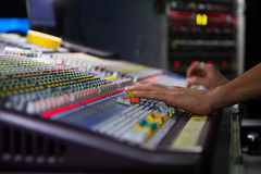 Soundman working on the mixing console. Royalty Free Stock Images