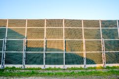 Soundproof wall by the roadside. Stock Photo