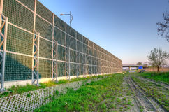 Soundproof wall by the roadside. Royalty Free Stock Images