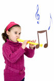 Sounds of flutes. Little girl makes music with an flute Royalty Free Stock Photos
