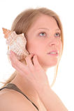 Sounds from seashell Stock Photo