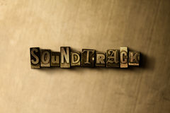 SOUNDTRACK - close-up of grungy vintage typeset word on metal backdrop Royalty Free Stock Photography