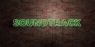 SOUNDTRACK - fluorescent Neon tube Sign on brickwork - Front view - 3D rendered royalty free stock picture Royalty Free Stock Image