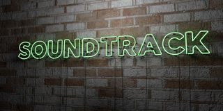 SOUNDTRACK - Glowing Neon Sign on stonework wall - 3D rendered royalty free stock illustration Stock Photos