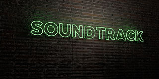 SOUNDTRACK -Realistic Neon Sign on Brick Wall background - 3D rendered royalty free stock image Royalty Free Stock Photo