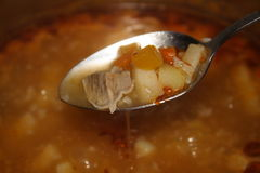 Soup. Testing boiling soup whith meat Royalty Free Stock Images