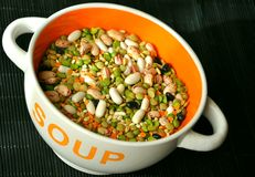 Vegan soup with lentils, peas and beans in a bowl Stock Images