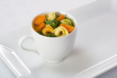 Soup. Cup of soup on white plate Royalty Free Stock Photo