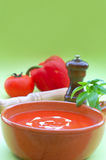 Soup. Fresh healhty tomato soup garnished with heart shaped cream drops and basil stock photos