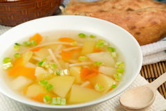 Soup. Vegetable soup with noodles and bread Royalty Free Stock Photography