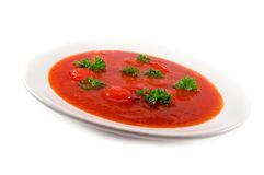Soup. Red tomato soup on white background stock images