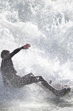 Into the Soup. A surfer turning toward a breaking wave stock images