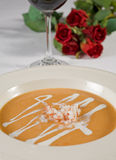 Soup appetizer a la carte. With red wine and roses Royalty Free Stock Photos