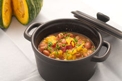 Soup with beans and squash with chilli powder Royalty Free Stock Image