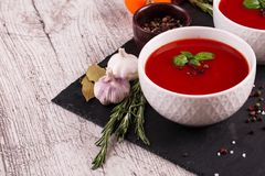 Beef and vegetables soup with tomato and dill. Ukrainian borscht on a white background. stock photos