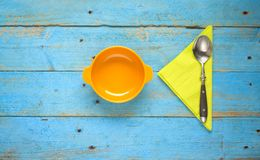 Soup bowl, napkin and spoon Royalty Free Stock Photography