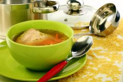 Soup in bowl and stainless steel pan. Stock Photos